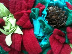 Use festive colours for Christmas decorations, with added pine cones for a special effect