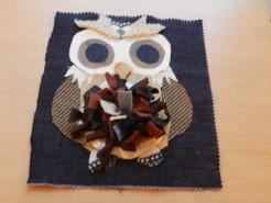 A collage card of the Hulton Crafts owl using paper and fabric